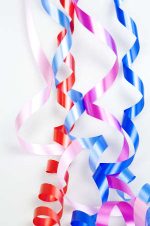 varicolored decorative ribbons on a white background photo