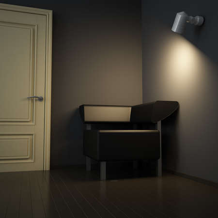 Dark interior with door and sofa and light from electric lamp photo