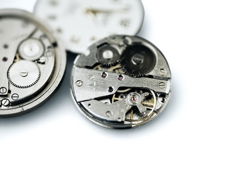 Old metal mechanical clock with gear wheels on a white background Stock Photo