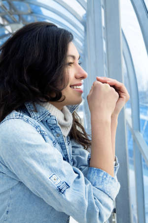 attractive girl in a denim jacket in a modern building against windows Stock Photo - 9357690