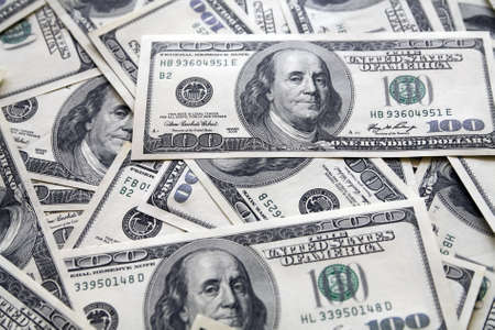 greenbacks: background from chaotically lyings one hundred greenbacks