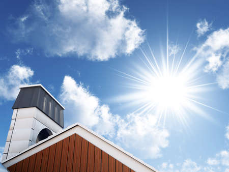 heat home: sun and blue sky over an house roof