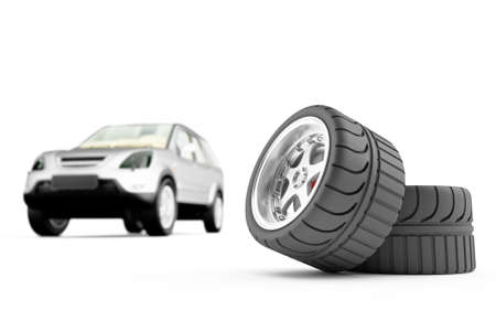 Two automobile wheels on a back background the car photo