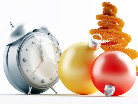 Yellow and red metallic christmas decorations and alarm clock photo