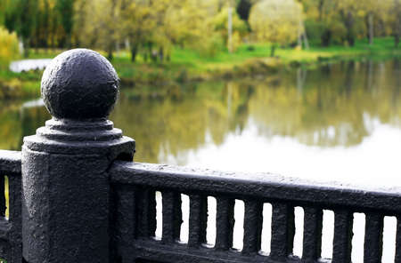 forged handrail of the bridge over the river in autumn day Stock Photo - 10537458