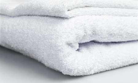 laundry concept: Some white towels in a pile