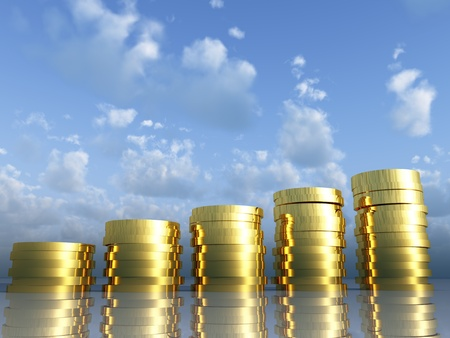 Golden coins on a background of the blue sky photo