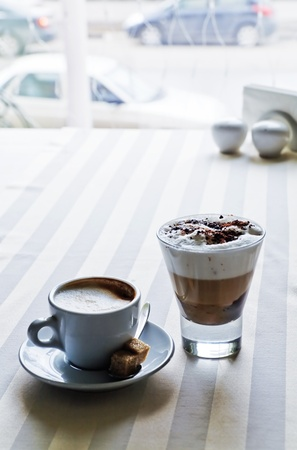 hot coffees: Appetizing coffee with sugar on a table in modern cafe
