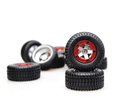 Rubber tires on red rims on a white background photo