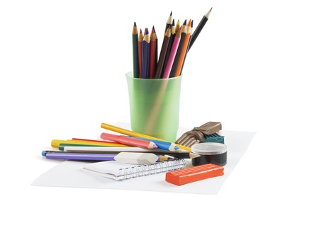Multi-colored pencils in a glass on a white background photo