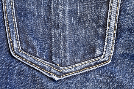 cloth back: fashionable shabby blue jeans with sewn pocket