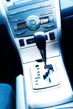 Interior of the modern car with buttons and the lever photo