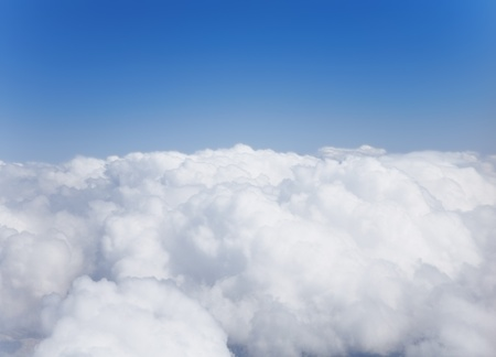 above the clouds: Fluffy white cumulus clouds against the sky Stock Photo
