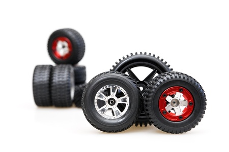Rubber tires on red rims on a white background Stock Photo - 12407244