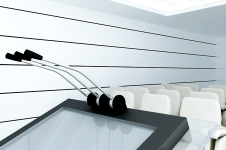 Microphoneson stand  in modern conference room photo