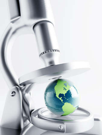 Researching of earth globe under magnification with microscope Stock Photo