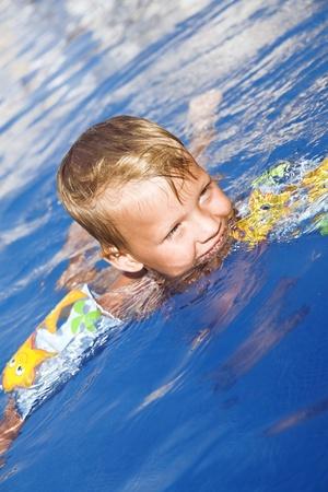 Little boy in pool water Stock Photo - 12610645
