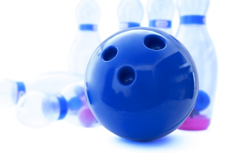 bowling alley: pins and ball for play in bowling on a white background