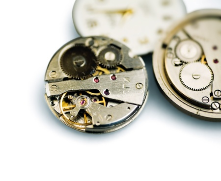 cog wheels: Old metal mechanical clock with gear wheels on a white background Stock Photo