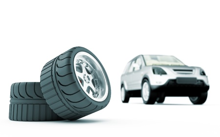 three wheel: Two automobile wheels on a back background the car Stock Photo