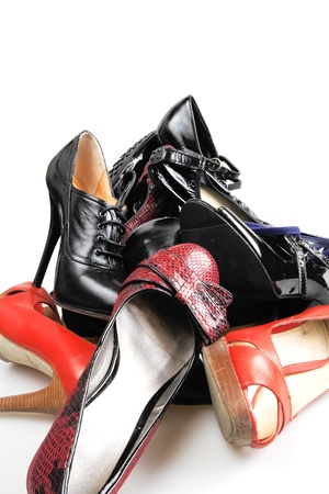 Heap of old female leather footwear on a high heel photo