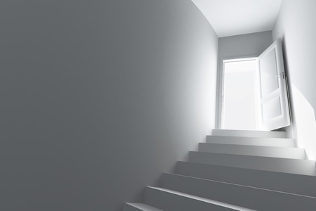 Spiral staircase to the open door Stock Photo - 13359771