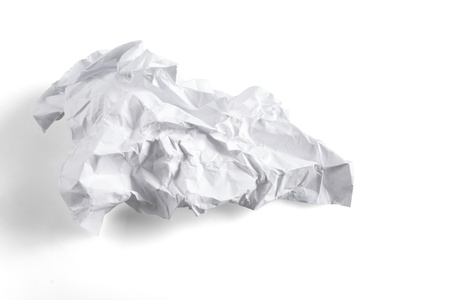 crumpled sheet of paper on a white background photo