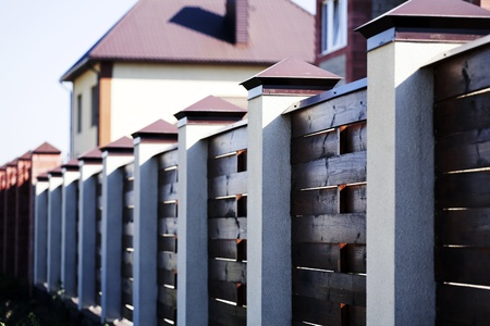 white picket fence: Fence and the modern house in suburban settlement Stock Photo
