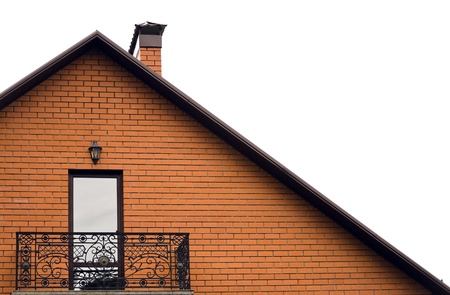 roof and balcony of house from red brick photo