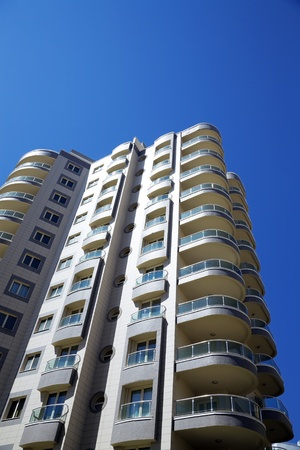 high modern residential building on a background blue sky photo