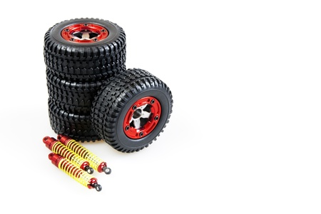 shock-absorbers and wheels of rc car on a white background photo