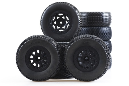 heap of wheels for radio-controlled models on a white background photo