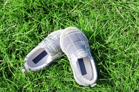 casual footwear on a juicy grass in summer day photo