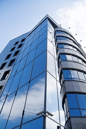 skyscraper window with bright blue sky reflected Stock Photo - 15411583