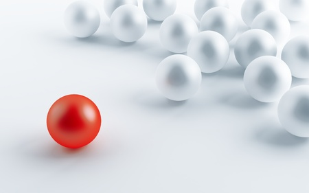 contrasting: many white balls and one contrasting red
