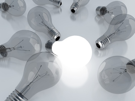 contrasts: many light bulbs and one is on