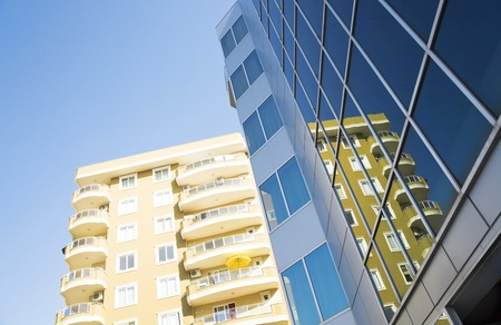 windows and balconies of modern residential buildings photo