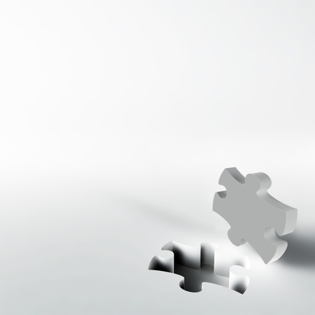 gray puzzle in the corner of white surface Stock Photo - 16801083