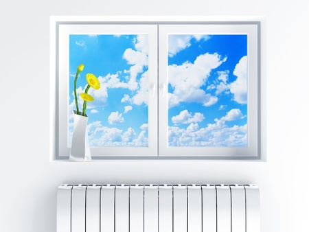 window with cloudy sky and flowers on sill photo
