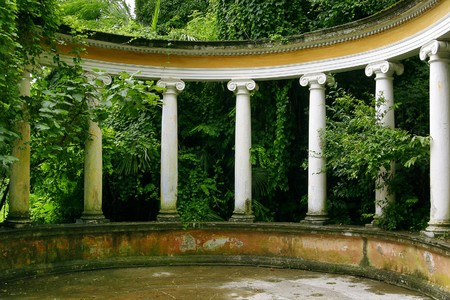 green vegetation: Light columns in classical style in an environment of green vegetation