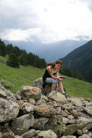The girl at the mountaines. Caucasus, summer. photo