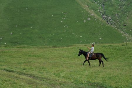 The boy on the horse. Caucasus, summer photo