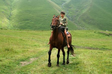The boy on the horse photo