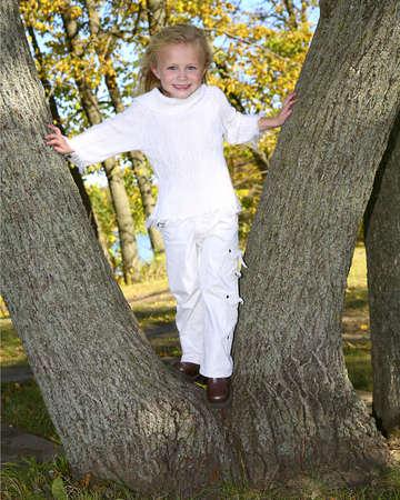 frolicking: child climbing tree