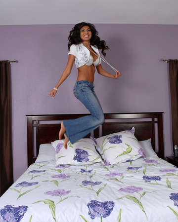 bedsheets: jumping on the bed Stock Photo