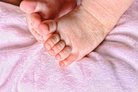 cradling: baby feet