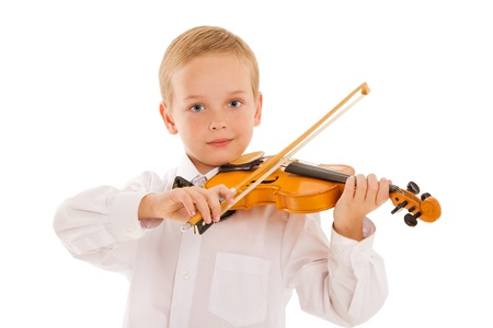 prodigy: The boy plays on a violin in studio on a white background
