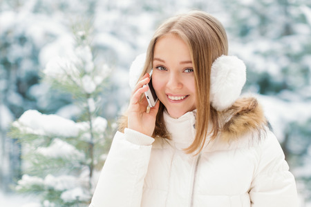 Portrait of a young girl in winter forest photo