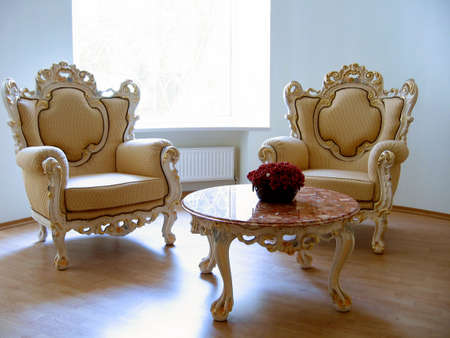 Two antique chairs and marble table photo