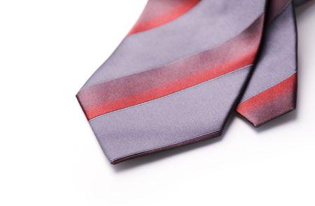 acomodador: Corbata de seda gris con franjas rojas Foto de archivo